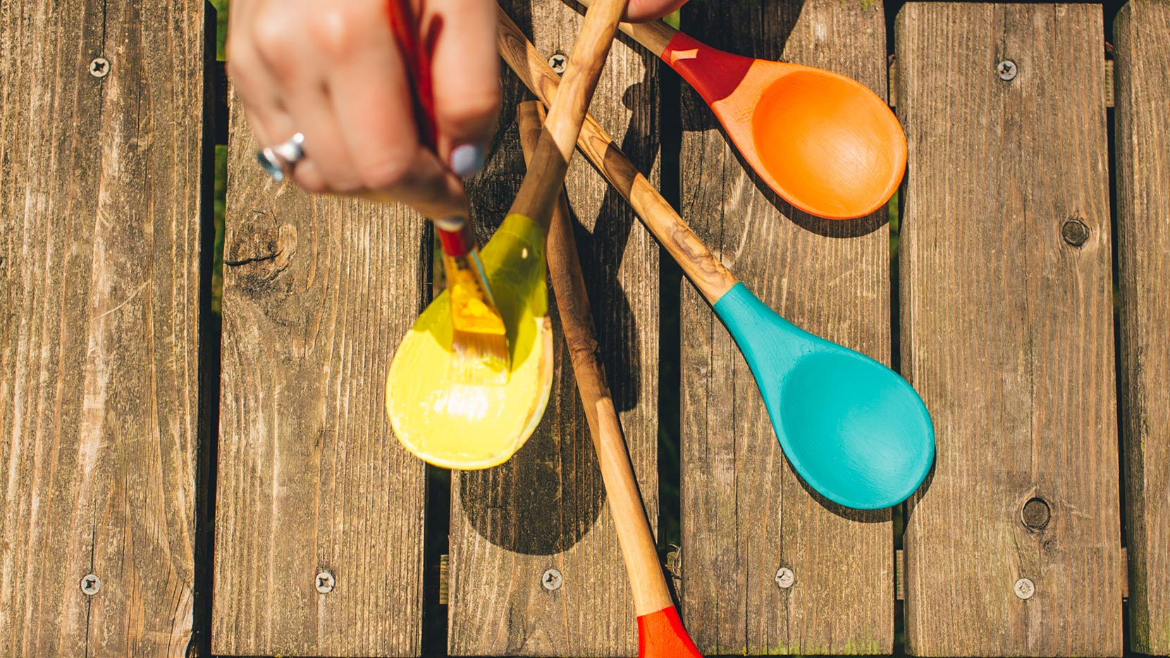 Paint each spoon a different color and write onto spoon names of the herbs you will plant (we love basil, thyme, rosemary and mint!)