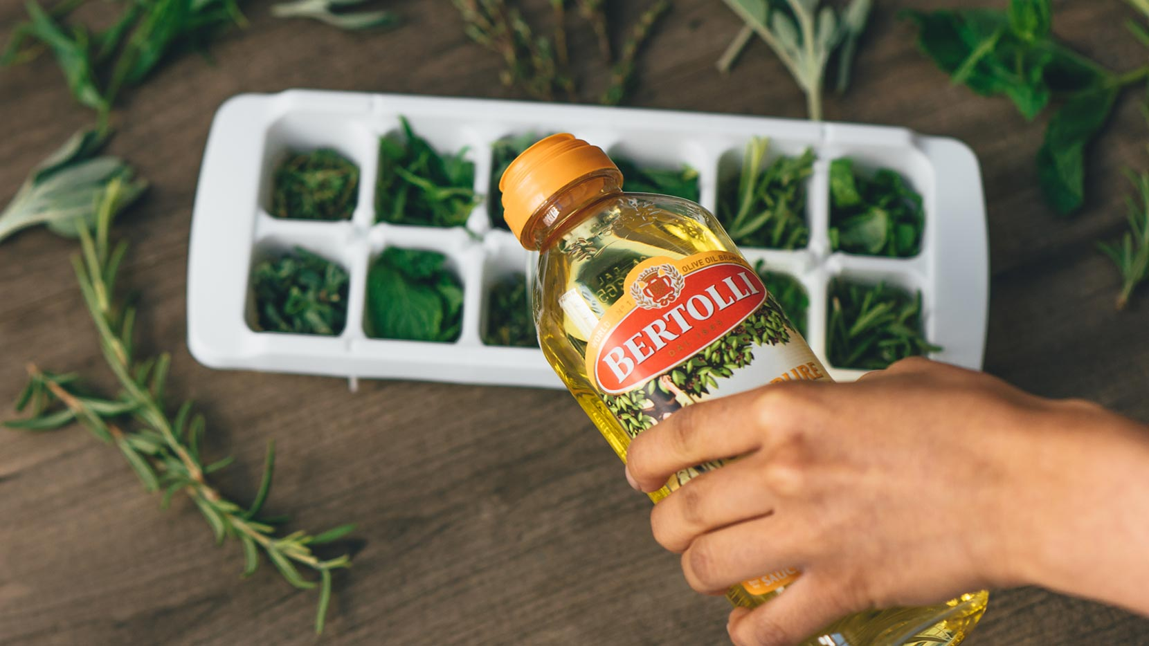Fill ice cube tray with Bertolli<sup>®</sup> 100% Pure Olive Oil and gently set in freezer to allow them to solidify
