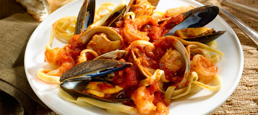 Sicilian Fish Stew Over Fettuccine